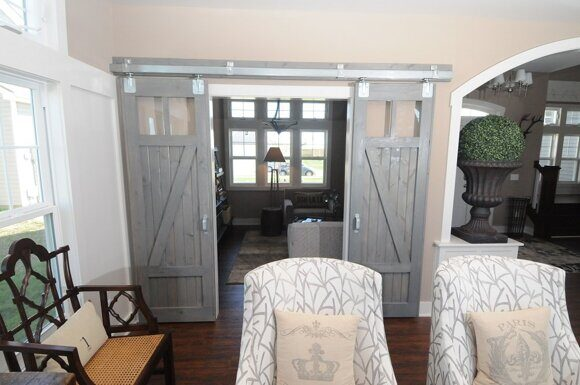 inspiration-decorations-picturesque-grey-finished-interior-barn-doors-for-homes-with-vintage-style-living-room-furniture-as-well-as-wooden-floors-and-grey-wall-painted-color-schemes-absorbing-barn-do